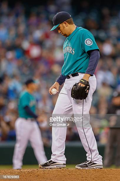 Starting pitcher Aaron Harang of the Seattle Mariners toes the rubber after giving up a tworun homer to Hank Conger of the Los Angeles Angels of...