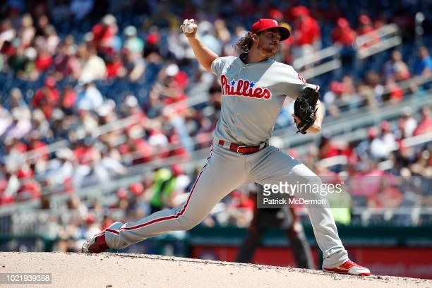 Starting pitcher Aaron Nola of the Philadelphia Phillies pitches in the second inning against the Washington Nationals at Nationals Park on August 23...