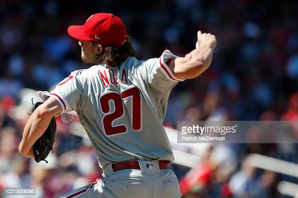 Starting pitcher Aaron Nola of the Philadelphia Phillies pitches in the seventh inning against the Washington Nationals at Nationals Park on August...