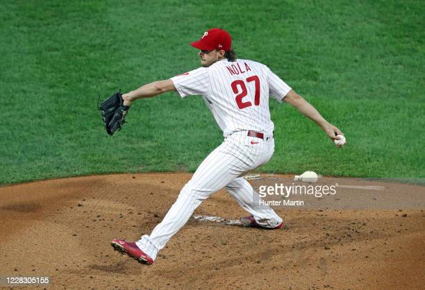 Starting pitcher Aaron Nola of the Philadelphia Phillies throws a pitch in the second inning during a game against the Washington Nationals at...