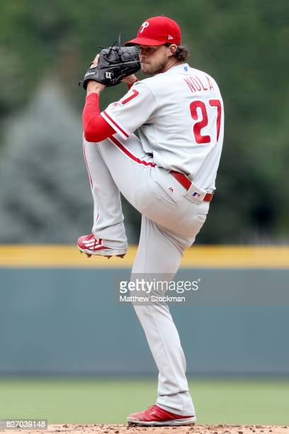 Starting pitcher Aaron Nola of the Philadelphia Phillies throws in the first inning against the Colorado Rockies at Coors Field on August 6 2017 in...