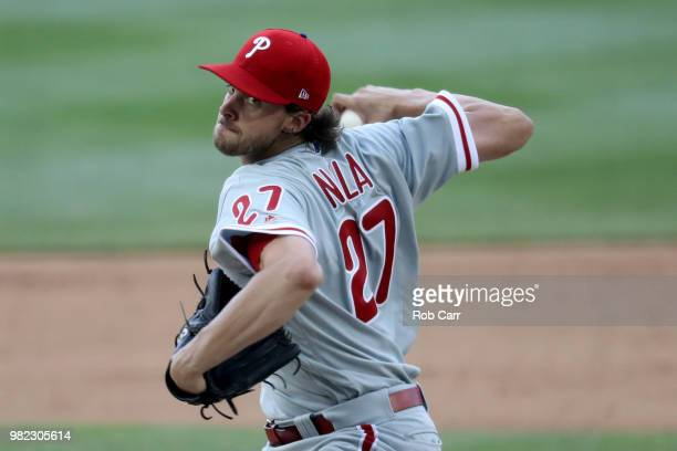 Starting pitcher Aaron Nola of the Philadelphia Phillies throws to a Washington Nationals batter in the fifth inning at Nationals Park on June 23...