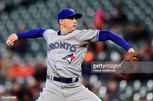 Starting pitcher Aaron Sanchez of the Toronto Blue Jays throws a pitch against the Baltimore Orioles in the first inning at Oriole Park at Camden...