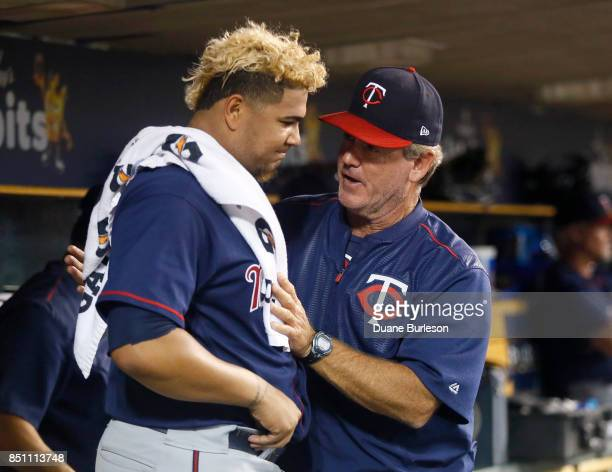 Starting pitcher Adalberto Mejia of the Minnesota Twins talks with pitching coach Neil Allen of the Minnesota Twins after leaving the game with a 41...