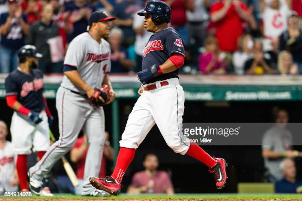 Starting pitcher Adalberto Mejia of the Minnesota Twins watches as Jose Ramirez of the Cleveland Indians scores during the first inning at...