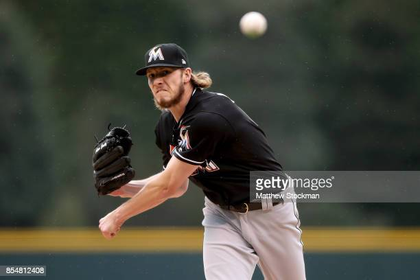Starting pitcher Adam Conley of the Miami Maralins throws in the first inning against the Coloarado Rockies at Coors Field on September 27 2017 in...