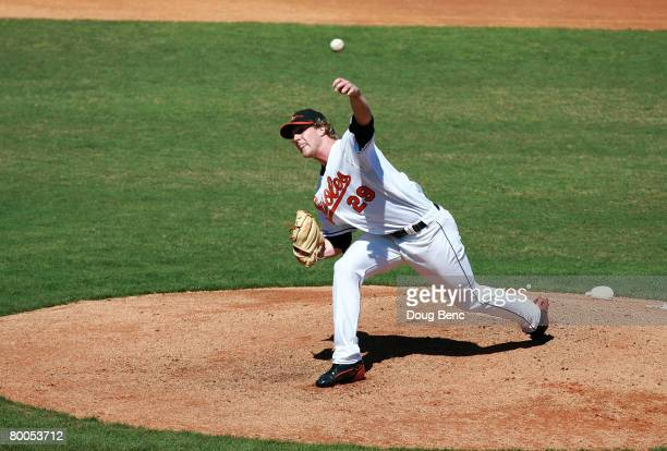 Starting pitcher Adam Loewen of the Baltimore Orioles pitches against the Florida Marlins at Fort Lauderdale Stadium February 28, 2008 in Fort...