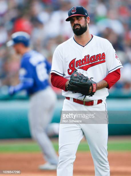 Starting pitcher Adam Plutko of the Cleveland Indians reacts after giving up a two run home run to Ryan O'Hearn of the Kansas City Royals during the...