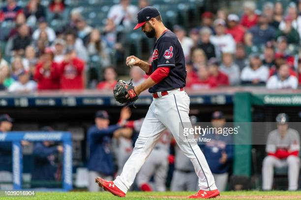 Starting pitcher Adam Plutko of the Cleveland Indians reacts after giving up a run on a wild pitch during the first inning against the Boston Red Sox...