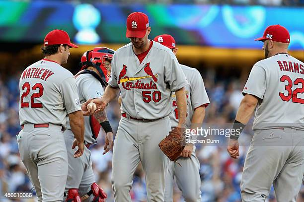 Starting pitcher Adam Wainwright of the St Louis Cardinals gives the ball to manager Mike Matheny as he leaves the game in the fifth inning of Game...