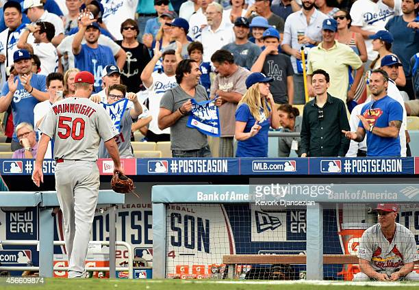 Starting pitcher Adam Wainwright of the St Louis Cardinals leaves the game in the fifth inning of Game One of the National League Division Series...