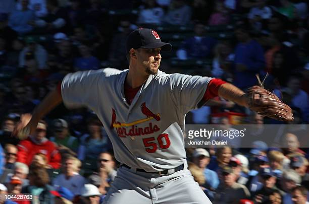 Starting pitcher Adam Wainwright of the St Louis Cardinals pitches his way to his 20th win of the season against the Chicago Cubs at Wrigley Field on...