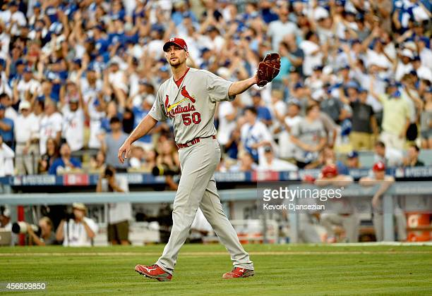 Starting pitcher Adam Wainwright of the St Louis Cardinals reacts after AJ Ellis of the Los Angeles Dodgers hits a tworun homerun in the fifth inning...