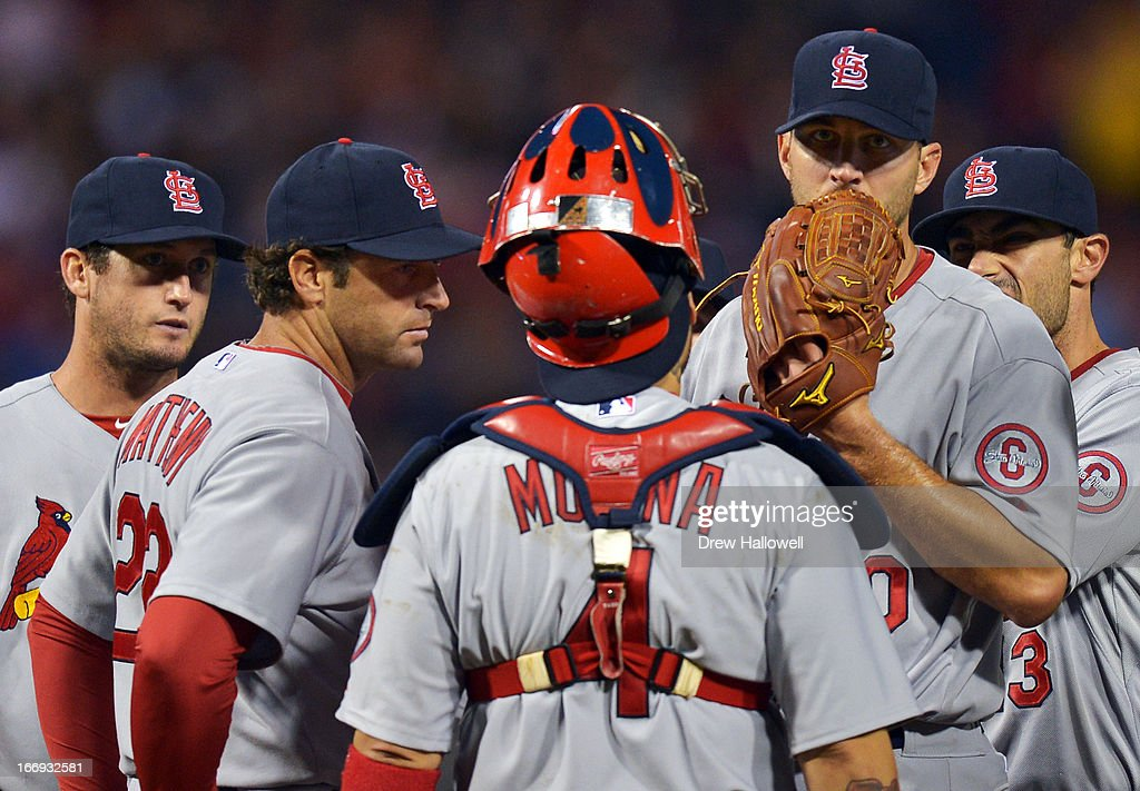 Starting pitcher Adam Wainwright #50 of the St. Louis Cardinals talks with manager manager Mike Matheny #22 and Yadier Molina #4 during the game against the Philadelphia Phillies at Citizens Bank Park on April 18, 2013 in Philadelphia, Pennsylvania. The Cardinals won 4-3.