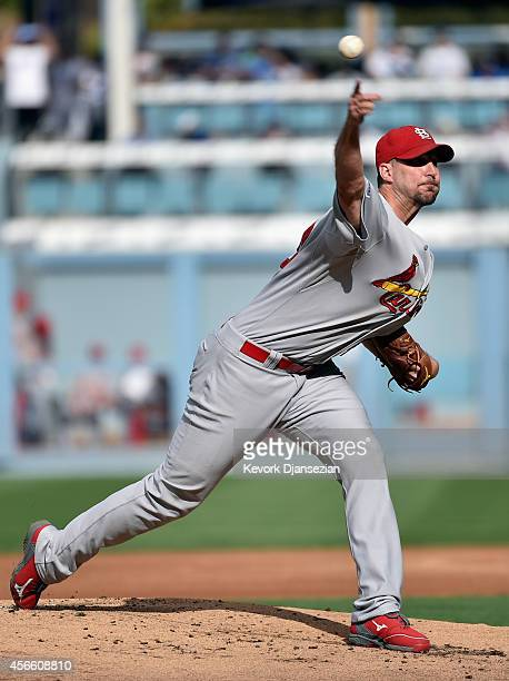Starting pitcher Adam Wainwright of the St Louis Cardinals throws in the first inning against the Los Angeles Dodgers during Game One of the National...