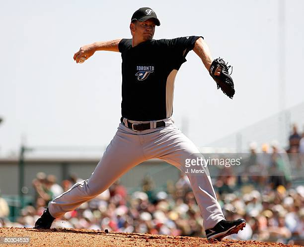 Starting pitcher AJ Burnett of the Toronto Blue Jays makes a pitch against the Pittsburgh Pirates during the Grapefruit League Spring Training game...