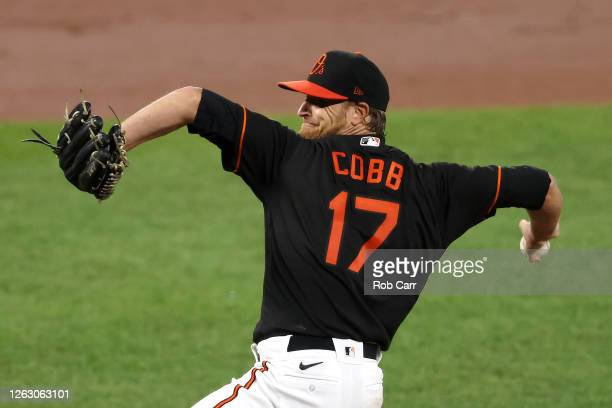 Starting pitcher Alex Cobb of the Baltimore Orioles throws to a Tampa Bay Rays batter in the second inning at Oriole Park at Camden Yards on July 31,...