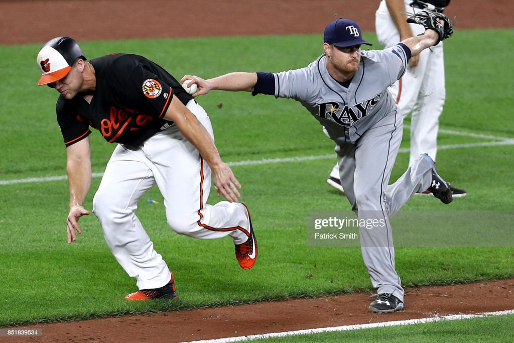 Starting pitcher Alex Cobb #53 of the Tampa Bay Rays tags out Chris Davis #19 of the Baltimore Orioles during the sixth inning at Oriole Park at Camden Yards on September 22, 2017 in Baltimore, Maryland.