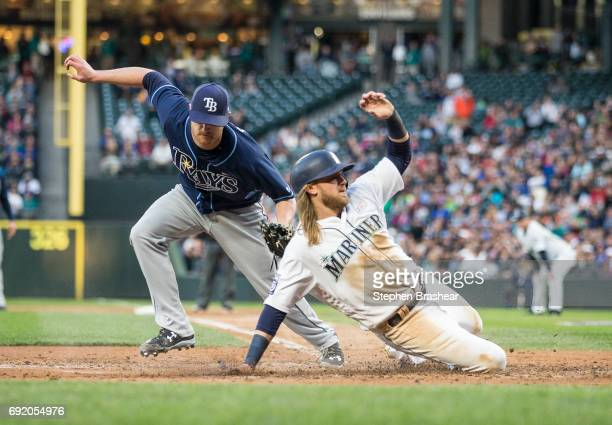 Starting pitcher Alex Cobb of the Tampa Bay Rays tags out Taylor Motter of the Seattle Mariners at home plate during the fourth inning of a game at...
