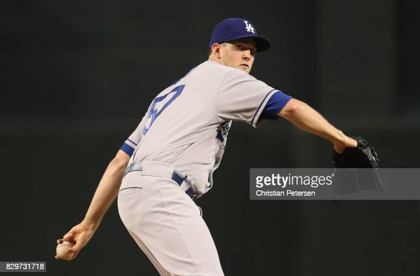 Starting pitcher Alex Wood of the Los Angeles Dodgers throws a warm up pitch during the first inning of the MLB game against the Arizona Diamondbacks...