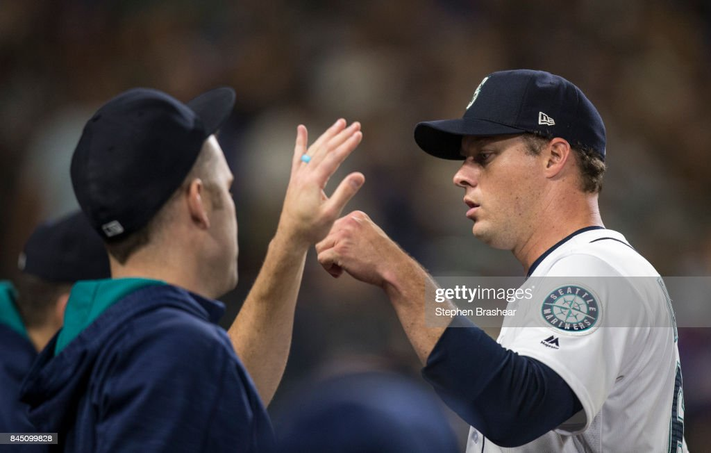 Starting pitcher Andrew Albers #63, right, of the Seattle Mariners is greet by starting pitcher David Phelps #46 of the Seattle Mariners after pitching the sixth inning of a game against the Los Angeles Angels of Anaheim at Safeco Field on September 9, 2017 in Seattle, Washington.