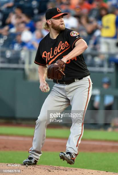 Starting pitcher Andrew Cashner of the Baltimore Orioles throws in the first inning against the Kansas City Royals at Kauffman Stadium on August 31...