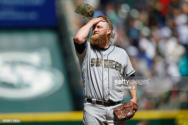 Starting pitcher Andrew Cashner of the San Diego Padres reacts after giving up a tworun homer to Kyle Seager of the Seattle Mariners in the sixth...