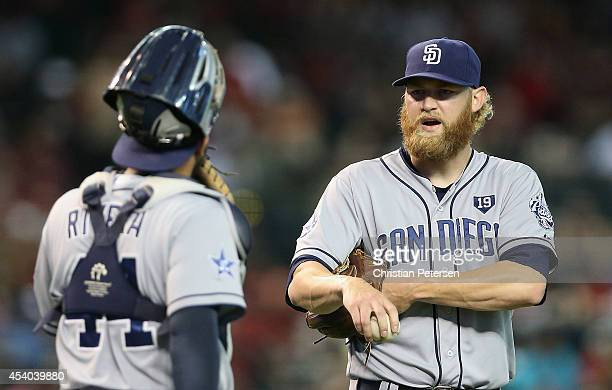 Starting pitcher Andrew Cashner of the San Diego Padres talks with catcher Rene Rivera during the MLB game against the Arizona Diamondbacks at Chase...