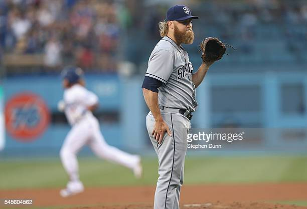Starting pitcher Andrew Cashner of the San Diego Padres waits for a new ball as Justin Turner of the Los Angeles Dodgers circles the bases after...