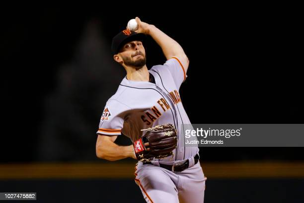 Starting pitcher Andrew Suarez of the San Francisco Giants delivers to home plate during the first inning against the Colorado Rockies at Coors Field...