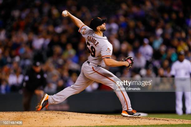 Starting pitcher Andrew Suarez of the San Francisco Giants delivers to home plate during the fourth inning against the Colorado Rockies at Coors...