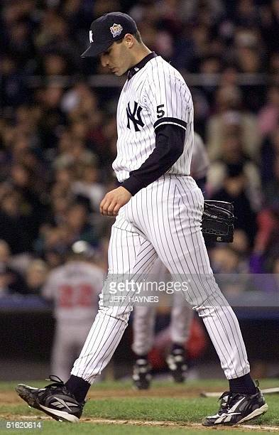 Starting pitcher Andy Petitte walks off the field after the third inning against the Atlanta Braves 26 October in game 3 of the 1999 World Series at...