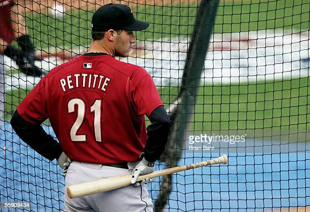 Starting pitcher Andy Pettitte of the Houston Astros waits for his turn in the batting cage prior to takin on the St Louis Cardinals in Game One of...