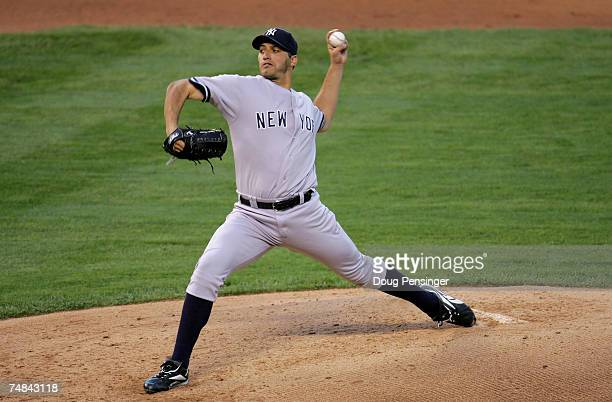 Starting pitcher Andy Pettitte of the New York Yankees delivers against the Colorado Rockies at Coors Field on June 20 2007 in Denver Colorado