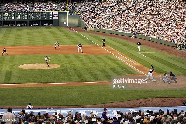 Starting pitcher Andy Pettitte of the New York Yankees pitches against Yorvit Torrealba of the Colorado Rockies on June 20 2007 at Coors Field in...