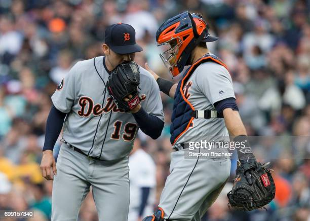 Starting pitcher Anibal Sanchez of the Detroit Tigers of the Detroit Tigers and catcher Alex Avila meet at the pitcher's mound during a game against...