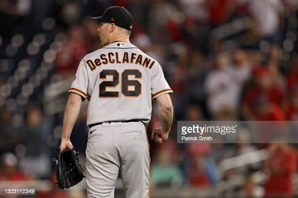Starting pitcher Anthony DeSclafani of the San Francisco Giants celebrates after defeating the Washington Nationals at Nationals Park on June 11,...