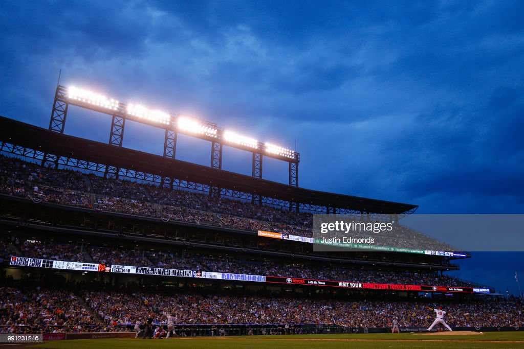 Starting pitcher Antonio Senzatela #49 of the Colorado Rockies delivers to home plate during the seventh inning in front of a sellout crowd against the San Francisco Giants at Coors Field on July 3, 2018 in Denver, Colorado.