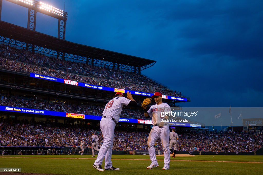 Starting pitcher Antonio Senzatela #49 of the Colorado Rockies congratulates Gerardo Parra #8 at the end of the seventh inning against the San Francisco Giants at Coors Field on July 3, 2018 in Denver, Colorado.