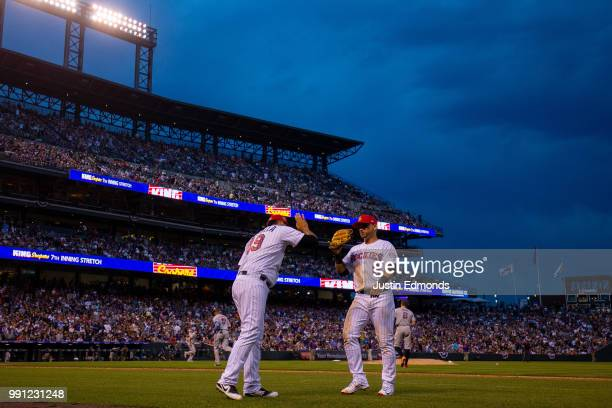 Starting pitcher Antonio Senzatela of the Colorado Rockies congratulates Gerardo Parra at the end of the seventh inning against the San Francisco...