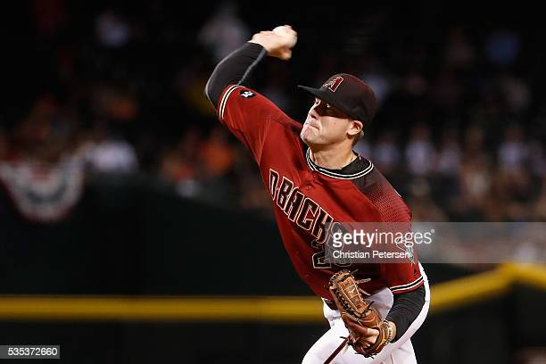 Starting pitcher Archie Bradley of the Arizona Diamondbacks pitches against the San Diego Padres during the first inning of the MLB game at Chase...