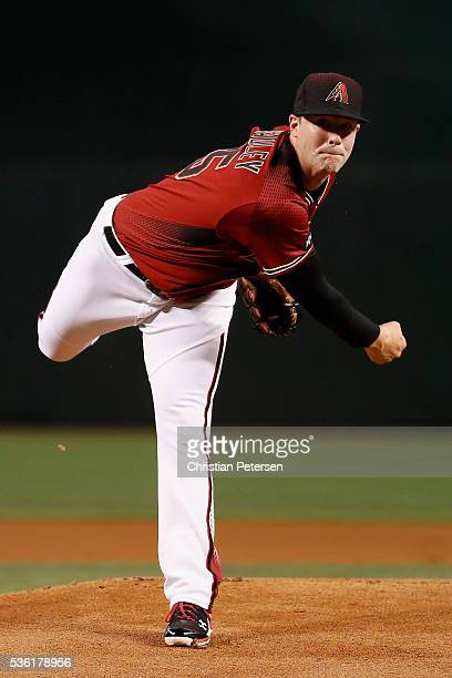 Starting pitcher Archie Bradley of the Arizona Diamondbacks throws a warm up pitch during the first inning of the MLB game against the San Diego...