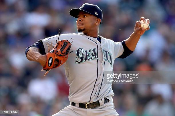 Starting pitcher Ariel Miranda of the Seattle Mariners throws in the third inning against the Colorado Rockies at Coors Field on May 30 2017 in...