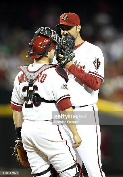 Starting pitcher Armando Galarraga of the Arizona Diamondbacks talks with catcher Miguel Montero during the Major League Baseball game against the St...