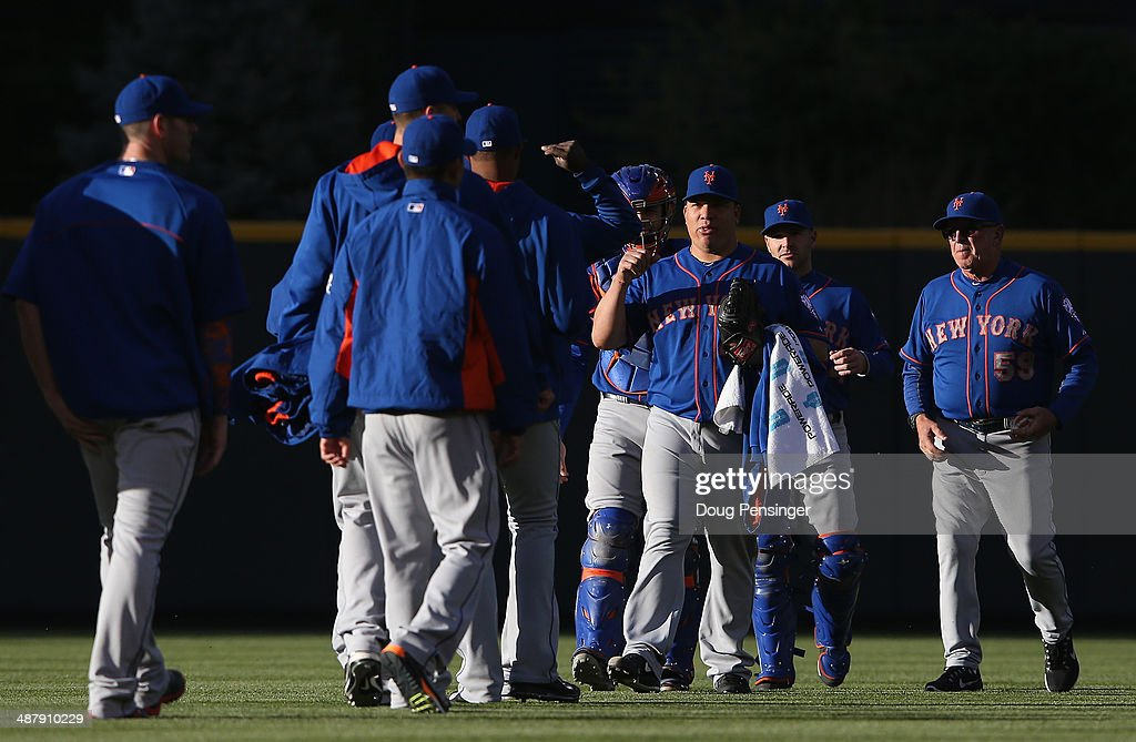 Starting pitcher Bartolo Colon #40 of the New York Mets is welcomed to the field by the bullpen pitchers prior to facing the Colorado Rockies at Coors Field on May 1, 2014 in Denver, Colorado. The Rockies defeated the Mets 7-4.