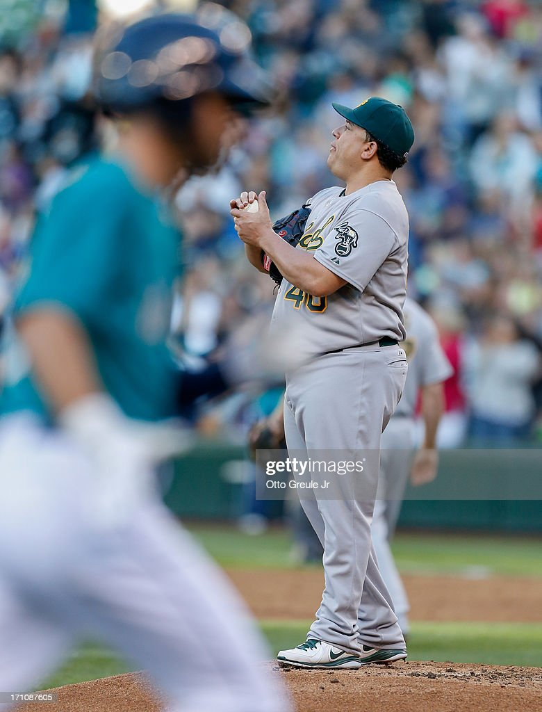 Starting pitcher Bartolo Colon #40 of the Oakland Athletics stands on the mound after giving up a three-run home run to Nick Franklin #20 of the Seattle Mariners in the third inning at Safeco Field on June 21, 2013 in Seattle, Washington.