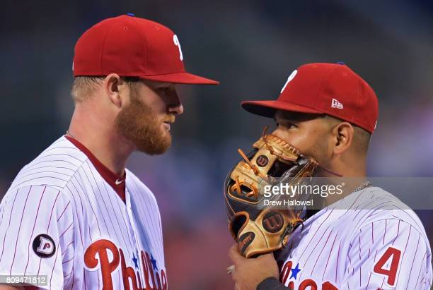 Starting pitcher Ben Lively of the Philadelphia Phillies talks with teammate Andres Blanco in the fourth inning against the Pittsburgh Pirates at...