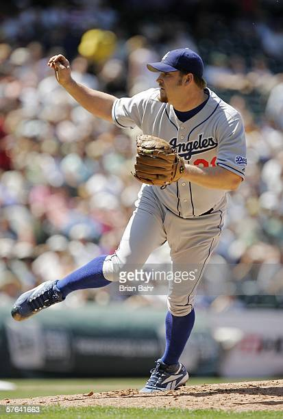 Starting pitcher Brad Penny of the Los Angeles Dodgers follows through on a pitch against the Colorado Rockies in the fourth inning May 17, 2006 at...