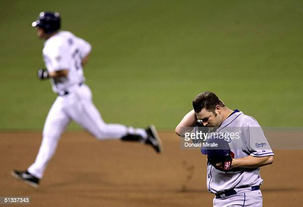 Starting Pitcher Brad Penny of the Los Angeles Dodgers looks down after giving up a home run to Phil Nevin of the San Diego Padres as he rounds third...