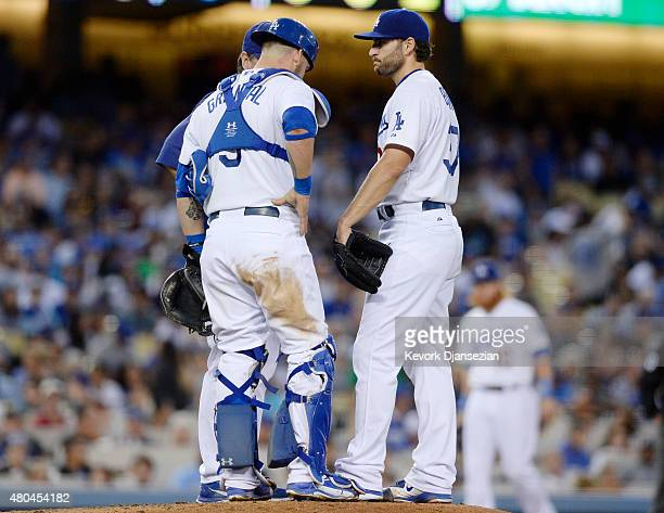 Starting pitcher Brandon Beachy gets a visit from catcher Yasmani Grandal and pitching coach Rick Honeycutt after giving up a threerun double to...